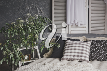White beige decoration in photo Studio, with the bed by the window.