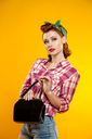 pin-up girl. beautiful young woman isolated on white in studio in old fashion clothes representing pinup and retro style