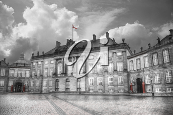 The Royal Amalienborg Palace in Copenhagen. Denmark. black and red and white photo