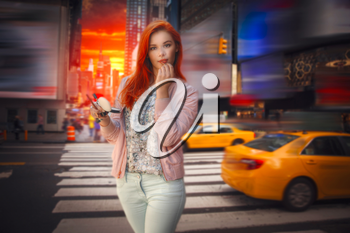 woman with red hair in New York paints lipstick lips