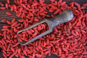 dry red berries, dry goji berries on a table