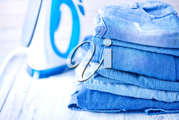 stack of jeans on the white plate