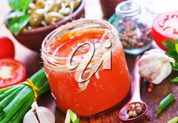 salsa in glass bank and on a table
