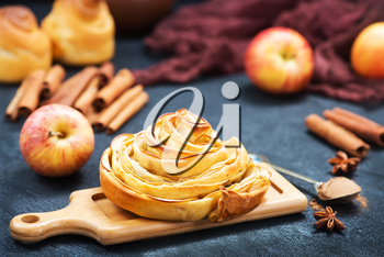 pie with apple and cinnamon on a table