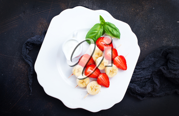 canape with strawberry and banana, fresh fruits, diet food