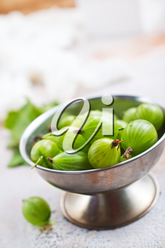 gooseberry in metal bowl, fresh gooseberry on a table