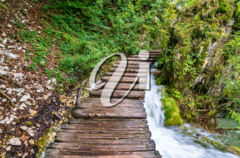 Wooden pathway above water at Plitvice National Park. UNESCO world heritage in Croatia