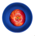Red apple in a blue bowl on a white background