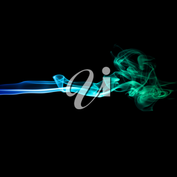 Abstract bright blue and green smoke on a dark background.