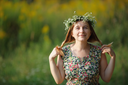 Smiling girl with a wreath keeps his hair. Sunset light. Space for text. Shallow depth of field. Focus on eyes.
