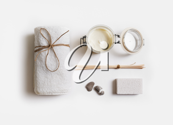 Spa treatment and beauty products on white paper background. Flat lay.