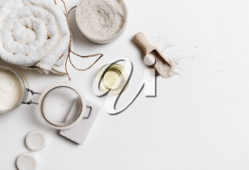 Composition of spa treatment products on white paper background. Space for text.