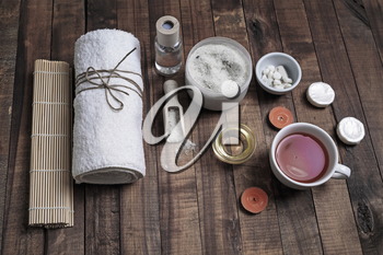 Spa threatment concept. Wellness and spa cosmetic products on vintage wood table background.