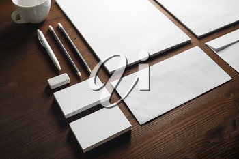 Photo of blank stationery set on wooden background. Corporate identity mock up for placing your design.