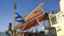 A lifeboat in case of an accident in the port or on a ship. The orange boat.