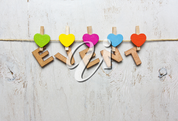 Word event of wooden letters on a white background with wooden clothespins