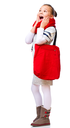 Cute girl with shopping bags, isolated over white