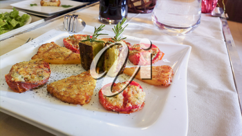 Meat and vegetable snacks. Aperitifs. Mediterranean cuisine on a white tablecloth in an Italian restaurant.