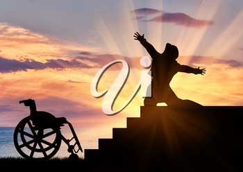 Concept of disability and positive. Silhouette of disabled person to experience happiness at the top of the stairs at sunset