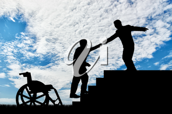 Man gives helping hand to disabled person in wheelchair day. Concept assistance disabled persons