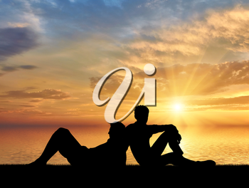 Homosexuals. Gay Couple lying relaxing at sunset by the sea