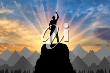 Silhouette happy climber on a mountain top. Concept of success and objectives