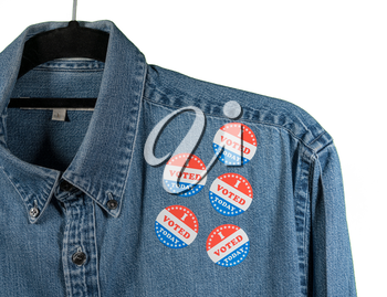 Multiple I Voted Today stickers on the blue denim working shirt collar for midterm elections in the USA with white background