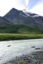 Mountain landscape. Highlands, the mountain peaks, gorges and valleys. The stones on the slopes.