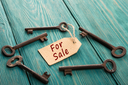 real estate sale concept - old key with tag
