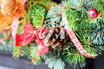 Closeup shot with Christmas decoration wreath and pine cone.