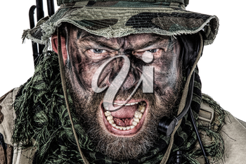 United States Commando face studio shot. Mouth opened, soldier yelling, emitting intimidate formidable frightening scream. Closeup portrait, cropped, isolated