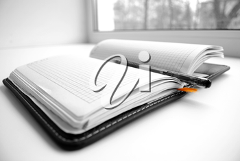 Open notebook with the handle, on white background.