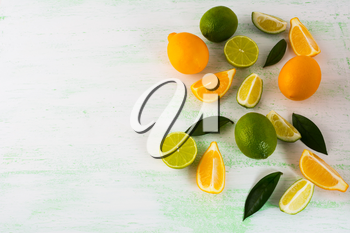 Citrus fruits mix on light green background. Healthy eating concept with lime and lemon. Fresh vegetarian food. Fresh mixed fruit. Fruit background.