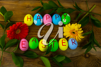 Easter eggs on a dark wooden background. Easter background. Easter eggs. Easter. Easter symbol.  Easter card. Easter greetings. Happy Easter