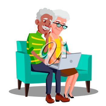 Multi Ethnic Couple Sitting On The Couch With Cup And Laptop Vector. Illustration