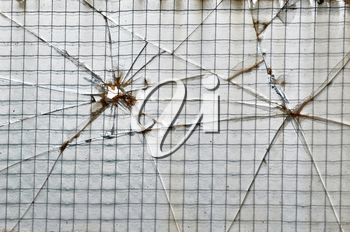 Smashed glass reinforced with wire squares background texture.