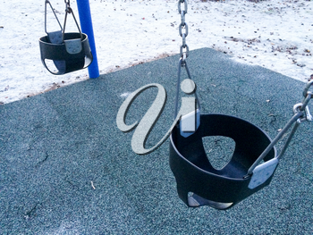 Empty swing at playground for baby and toddler saftey seat